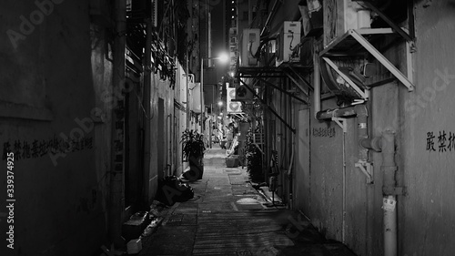 Canvas Print Empty Alley Amidst Buildings At Night