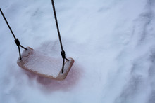 High Angle View Of Snow Covered Swing At Playground