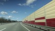 Video 4k, highway, cars and freight transport on a sunny day.