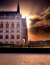 Hungarian Parliament Building Against Cloudy Sky At Sunset