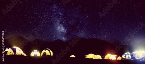 Fotografering Panoramic Shot Of Illuminated Tents Against Star Field