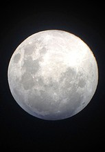 Scenic View Of Full Moon In Clear Sky At Night