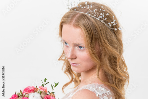 Portrait of romantic young bride in white lace wedding dress with fantasy makeup and wavy blonde hair Canvas Print