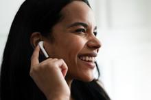 Woman Wearing Wireless Earphones