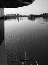 Cropped Image Of Tugboat On River Against Sky