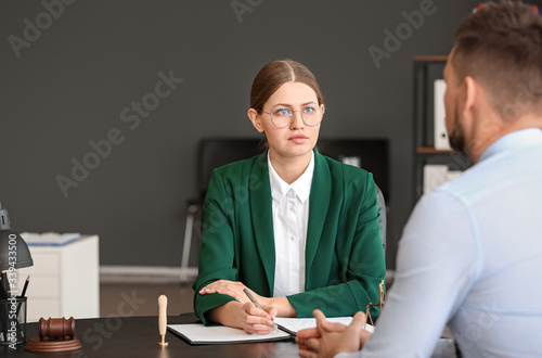 Female judge working with client in office Wallpaper Mural