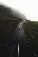 Man Walking On A Road In Iceland