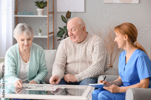 Fotografía Elderly people suffering from mental disability and caregiver in nursing home