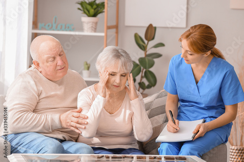 Cuadros en Lienzo Elderly people suffering from mental disability and caregiver in nursing home