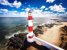 Itapua Lighthouse At Beach