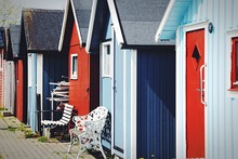 Multi Colored Huts By Street