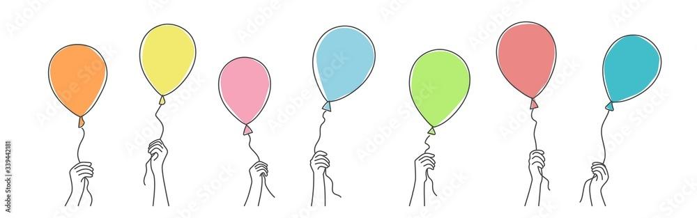 Fototapeta Hands holding balloons. Hand drawn vector illustration