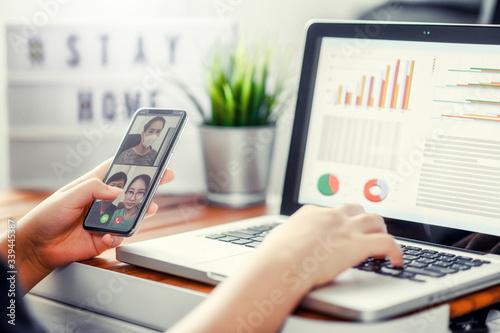 Fotografie, Obraz Hand using smartphone Virtual talking with friends