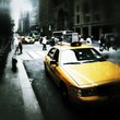 Yellow Taxis And People On City Street
