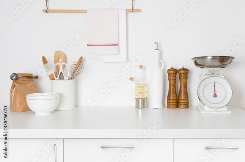 Fotomural Minimalistic modern kitchen in pastel colors with kitchenware and space