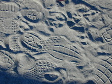 High Angle View Of Shoe Prints On Sand