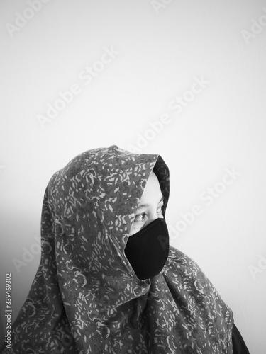 Muslim woman in hijab and reusable protective fabric face mask Canvas Print