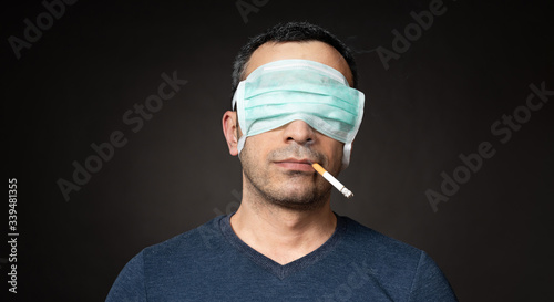 Stampa su Tela Man Closed His Eyes with a Protective Mask to the Potential Consequences of Cons