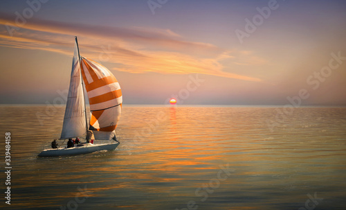 Fototapety marynistyczne   sailing-ship-sailing-in-the-rays-of-the-setting-sun-the-golden-color-of-the-sun