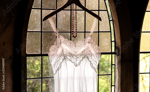 Fototapeta backlit retro vintage lacy slip in church window