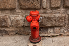 A Red Fire Hydrant In A City S...