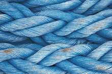 Nautical Background. Old Blue Frayed Ship Rope Closeup. Classic Blue Texture.