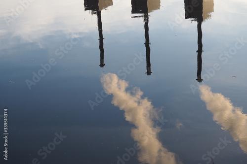Foto Reflection Of Smoke Stack On Lake