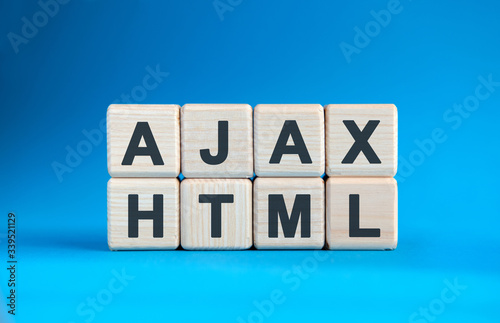 Photo AJAX HTML - text on wooden cubes on a blue gradient background