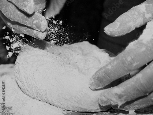 Obraz Cropped Image Of Person Making Bread - fototapety do salonu