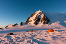 Colorful Tents In Snow At Sunrise In Col Du Midi, Under Mont Blanc Du Tacul, Massif Of Mont Blanc, Chamonix, French Alps