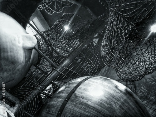 Tablou Canvas High Angle View Of Birdcages For Sale At Street Market During Night