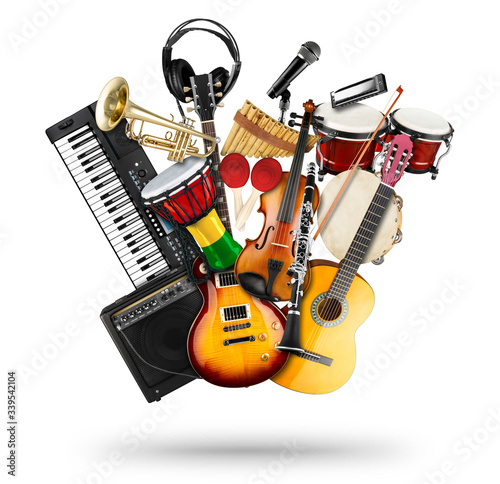 stack pile collage of various musical instruments. Electric guitar violin piano keyboard bongo drums tamburin harmonica trumpet. Brass percussion studio music concept isolated white background