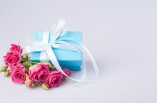 Blue Gift Box With White Ribbo...