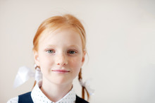 Smiling Red-haired Schoolgirl ...