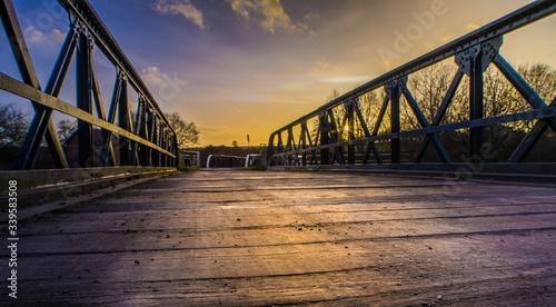 Canvas Print Footbridge Against Sky During Sunset