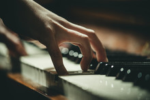 Hand On Piano Keys Close-up