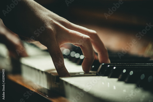 Fototapety, obrazy: hand on piano keys close-up