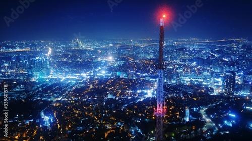Fototapeta Illuminated City Against Sky At Night obraz