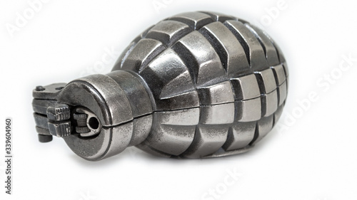 Single silver metal grenade - lighter isolated on white background with shadow a Canvas Print