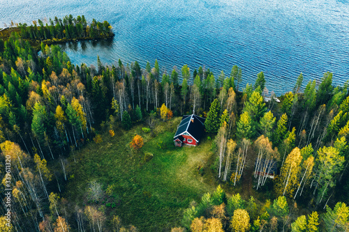 Aerial top view of red log cabin or cottage with sauna in spring forest by the l Tapéta, Fotótapéta