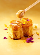 Honey Cake With Drizzled Honey And Flower Petals
