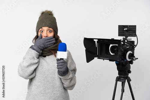 Fototapeta Reporter woman holding a microphone and reporting news over isolated white backg