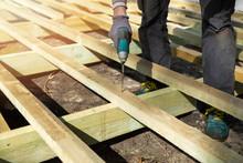 Man Building Wooden Frame For ...