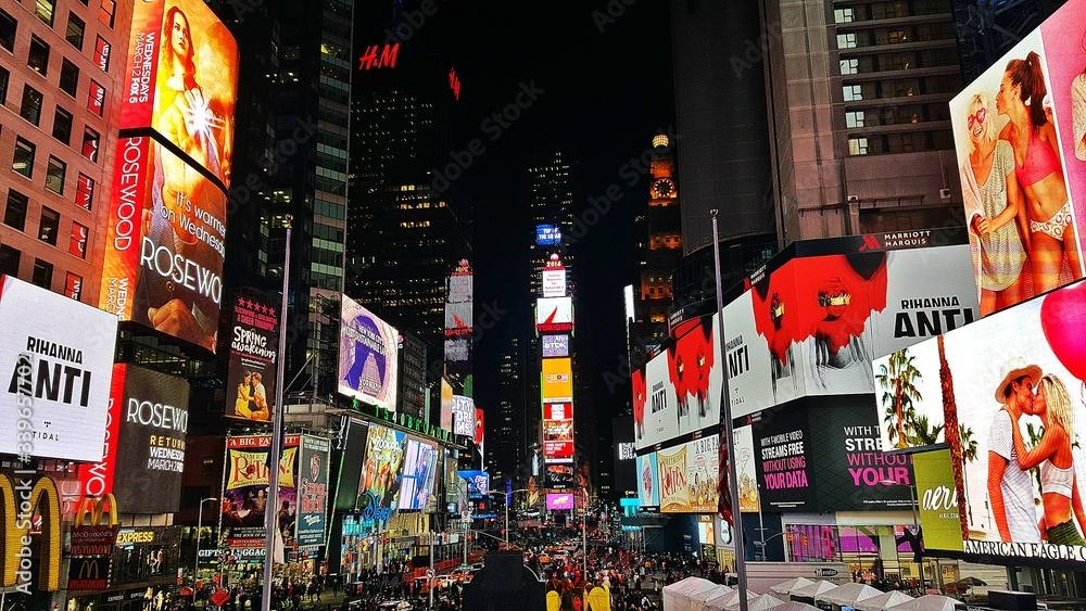 Fototapeta Billboards On Illuminated Buildings In Times Square