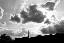Silhouette Eiffel Tower Against Sky And Clouds
