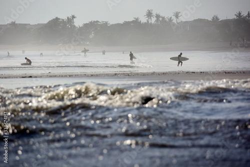 Obraz Surfers Walking At Beach - fototapety do salonu