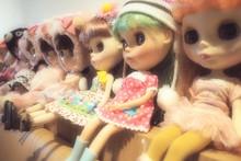 Dolls Arranged On Shelf At Home