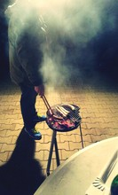 Man Barbecuing Food