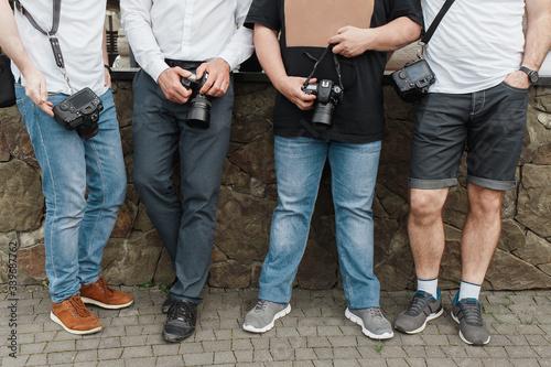 four photographers Canvas Print