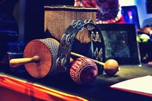 Close-up Of Maraca And Tambourine On Table